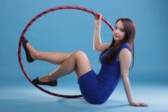Dance hoop Beautiful woman in blue Stock Image