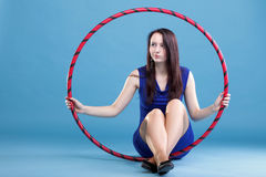 Dance hoop Beautiful woman in blue Stock Images