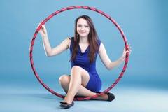 Dance hoop Beautiful woman in blue Stock Images