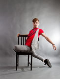 Dancer improvising. In studio with a chair stock photo