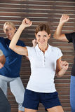 Dance instructor in dancing class. Happy dance instructor in dancing class for senior citizens Stock Photos