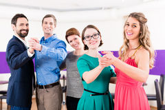 Dance instructor with gay couples in dancing class Stock Image