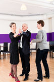 Dance instructor with senior couple Royalty Free Stock Image