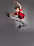Dance jump. Young modern dancer jumps high royalty free stock images