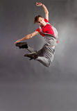 Dancer jumping. Young modern dancer jumping high stock photography