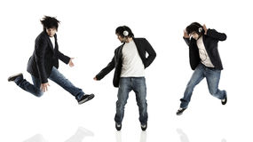 Dance and Jumping. Young modern man dancing over a white background Royalty Free Stock Photo