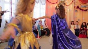 Dance in kindergarten. 30.12.2014 Ukraine, Lviv girls dance the dance of snowflakes on Christmas celebration in kindergarten stock video