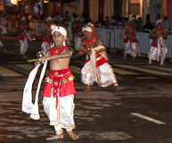 A Dance of Kothala performer parades through the streets of Kandy during the Esala Perahera in Sri Lanka. Stock Photo