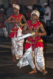 Dance of Kothala performers parade through the streets of Kandy during the Esala Perahera in Sri Lanka. Stock Images