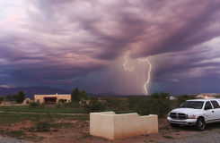 A Dance of Lightning in the Foothills. PALOMINAS, ARIZONA - JULY 15: The Mule Mountain foothills on July 15, 2013, near Palominas, Arizona. Lightning strikes the Royalty Free Stock Photography