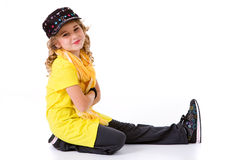 Dance: Little Girl Hip Hop Dancer with Smile Sitting On Ground Royalty Free Stock Photos