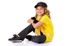 Dance: Little Girl Hip Hop Dancer with Smile Sitting On Ground Royalty Free Stock Images