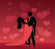 Dance of love. Silhouette of a man and a woman dancing on a red background with defocused hearts Stock Images