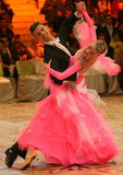 Couple Dancing on Ballroom Floor, Lady in Pink  Stock Photo