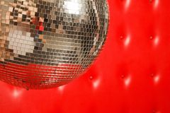 Dance mirror ball on leather background. Dance mirror ball on red leather background Royalty Free Stock Photos