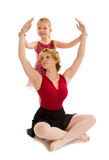 Dance Mom Ballet Student with Child Teaching Lesson. A Dance Mom Ballerina Being Taught By her Tiny Tot Ballet Student Who Positions Hands Royalty Free Stock Image