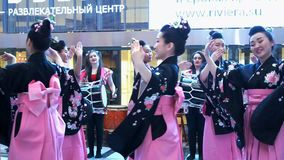 Dance. Moscow, Russia - March 24, 2017: group of japanese geishas in traditional japanese kimono dancing in a mall Riviera. The performance dedicated to the new stock video footage