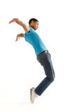 Dance move. Breakdancer does expressive move and bends backwards isolated on white Royalty Free Stock Images