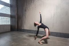 Dance, movement concept. Blonde woman dancing in contemporary st. Yle. Studio shot royalty free stock photography