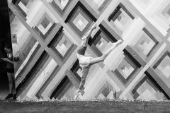 Dance and Movement next to Texting Distraction, Wynwood Walls, Florida, USA. A young dancer creates movement against an abstract background at the Wynwood Walls stock image