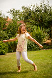 Dance is my joy. Active childhood - happy child dancing outdoor in backyard Royalty Free Stock Photography