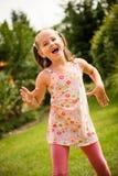 Dance is my joy. Active childhood - happy child dancing outdoor in backyard Royalty Free Stock Images