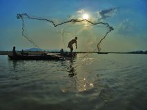 Dance in nature. Two brothers are fishing in Lak lake Stock Image