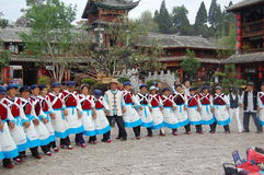 The dance of naxi race. In the  sifang street of old city of lijiang i saw the naxi race dancing to celebrate the harvest Stock Photo