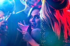 Dance party with group people dancing and disco ball. Dance party with group people dancing. How to pick up girls at a club. Women and men have fun in night Stock Photo