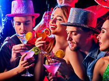 Dance party with group people dancing and disco ball. Woman disco night club. Dance party with group people dancing. Female and men have fun and drink martini Royalty Free Stock Photos