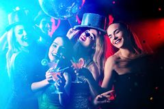 Dance party with group people . Dancing youth under drugs. Dance party with group people . Dancing youth under influence of drugs. Women and confident casual Royalty Free Stock Image