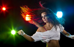 Dance Party. Young woman dancing at party with disco lights