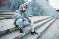 Dance performer sitting on the steps, urban style. Dance performer sitting on the steps, urban dancing style, street dancing. Male dancer Stock Photos