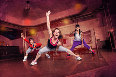 Dance power. Group of women in sport dress at fitness dance exercise or aerobics Stock Image