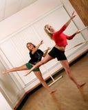 Dance practice. Two teen dancers practicing ballet routines in dance studio Royalty Free Stock Photos