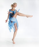 Dance - pretty active blonde girl in blue dress Royalty Free Stock Photo