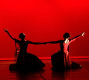 Dance in Red. Modern dance with red costumes and red backdrop Royalty Free Stock Images