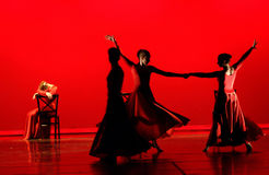 Dance in Red. Modern dance in red with red costumes and red background royalty free stock image