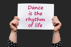 Dance is the rhythm of life. Motivational sign woman holding by hand Royalty Free Stock Image