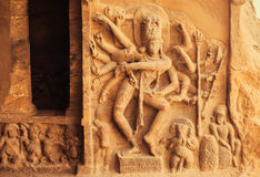 Dance of Shiva Lord with many hands. Entrance to the Hindu temple with 6th century reliefs. Ancient Indian architecture Stock Photos