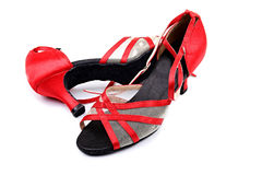 Dance shoes. Image of a  red salsa dance shoes on a white table Royalty Free Stock Photography