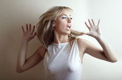 Dance and sing a song. Blonde lady dancing and singing a song Stock Photos