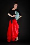 Dance. Spanish girl with fan dancing flamenco Royalty Free Stock Photos