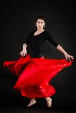 Dance. Spanish girl in red skirt dancing flamenco Stock Photo