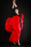 Dance. Spanish girl in red skirt dancing flamenco Stock Photography