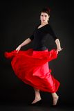 Dance. Spanish girl in red skirt dancing flamenco Royalty Free Stock Image