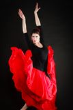 Dance. Spanish girl in red skirt dancing flamenco Royalty Free Stock Photos