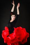 Dance. Spanish girl in red skirt dancing flamenco Royalty Free Stock Photography