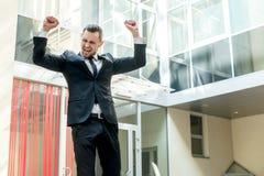 Dance success. Successful confident businessman celebrates his s Stock Images