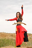 Dance with a sword. Tribal style Royalty Free Stock Image